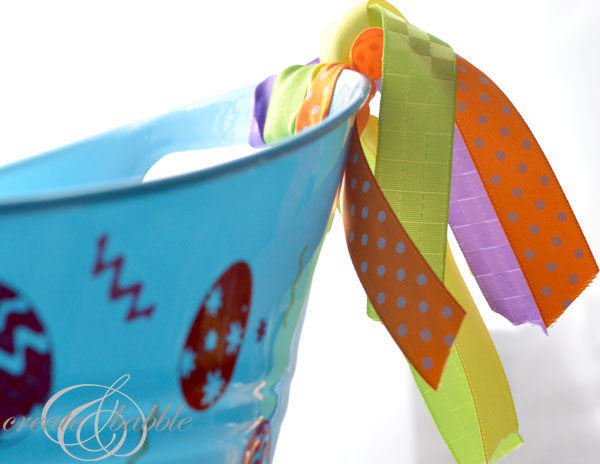 Vinyl decorated dollor tree bucket-createandbabble