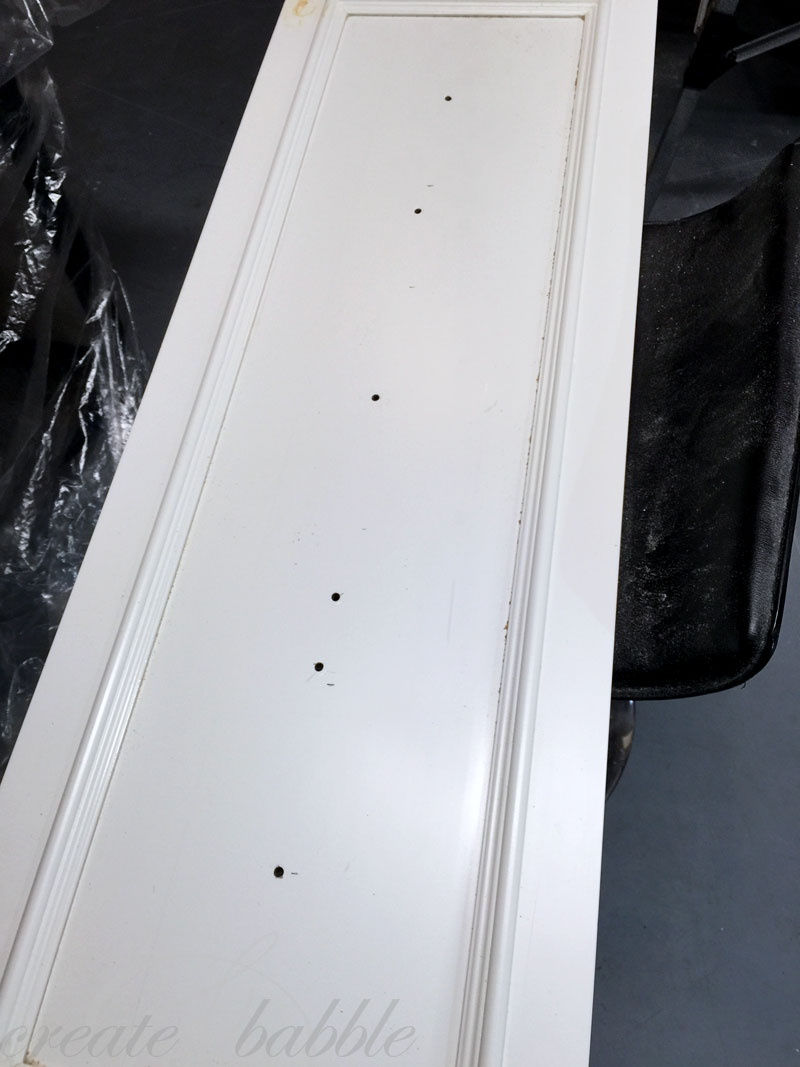 holes drilled in cupboard door upcycle