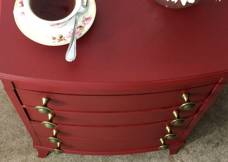 New hardware on red painted chest of drawers