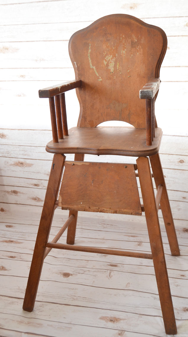 This old high chair needs repaired and restored