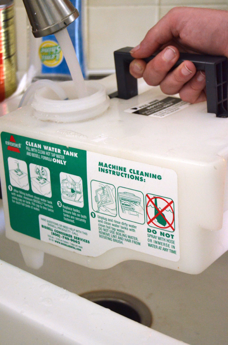 filling-clean-water-tank-of-bissell-carpet-cleaner