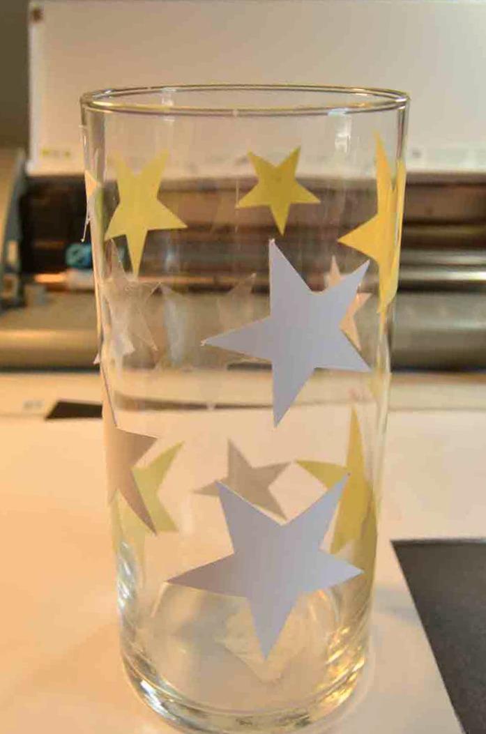 apply the adhesive stars to the dollar tree vase