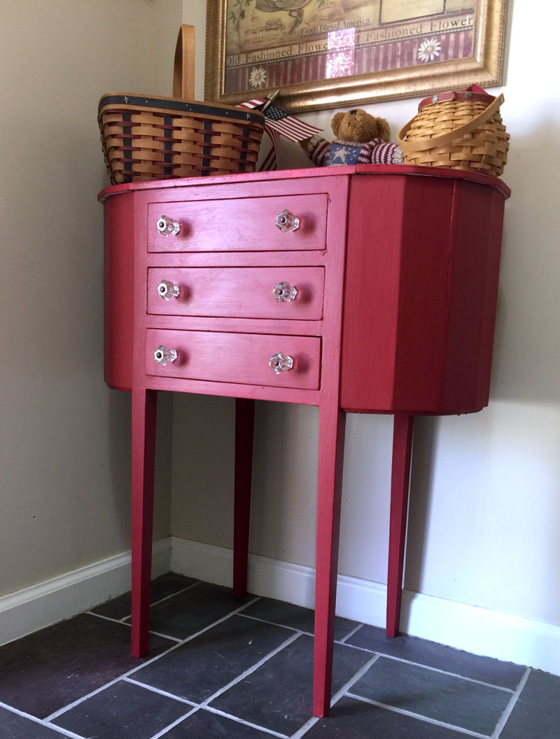 Red painted sewing cabinet