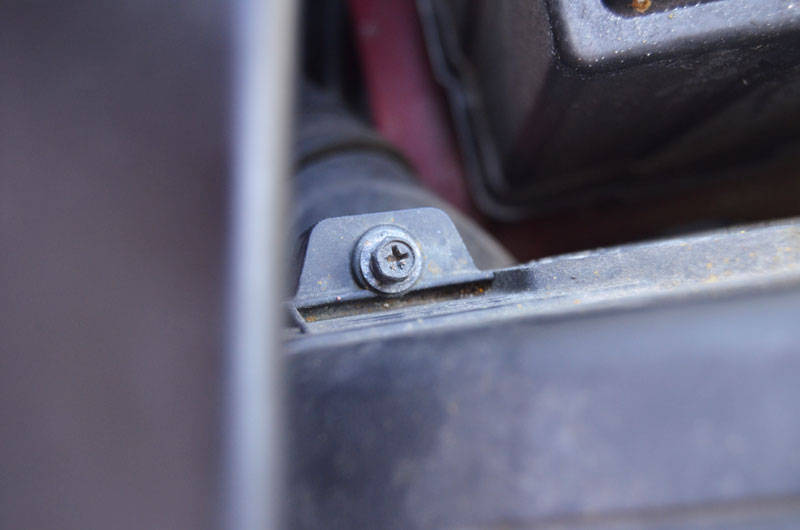 screw-holding-cover-on-in-my-car