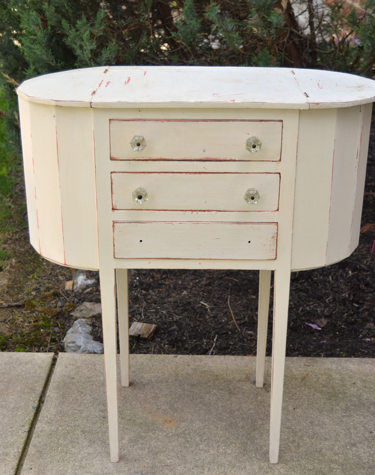 sewing cabinet with layers of paint needs a makeover