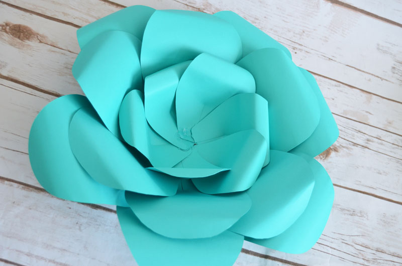 three layers of petal bowls are assembled to make extra large paper flowers