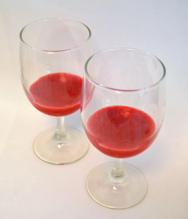 pour the puree into two glasses to make strawberry banana pina coladas