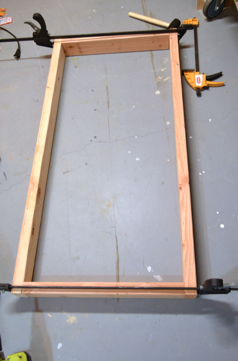 assembled frames using two by fours to make diy corn hole boards