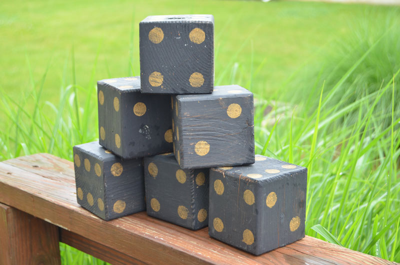 black and gold painted lawn dice