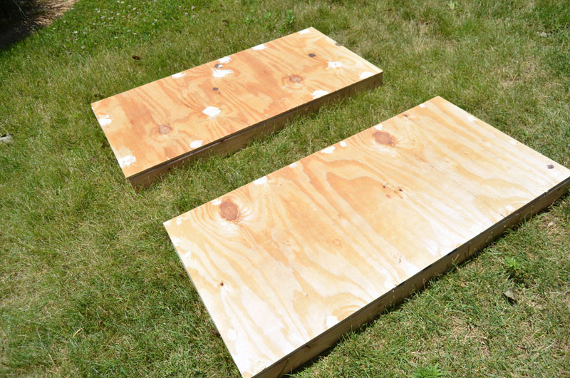 fill holes with wood filler and then sand entire corn hole board