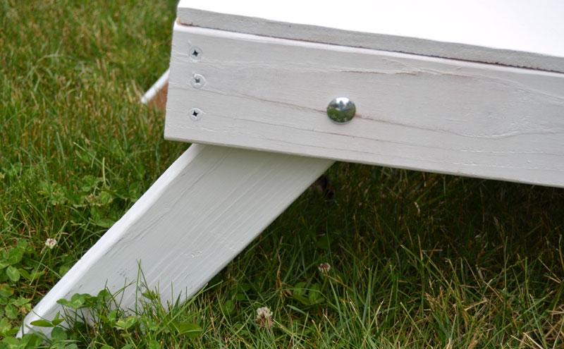 close-up-of-leg-to-corn-hole-board