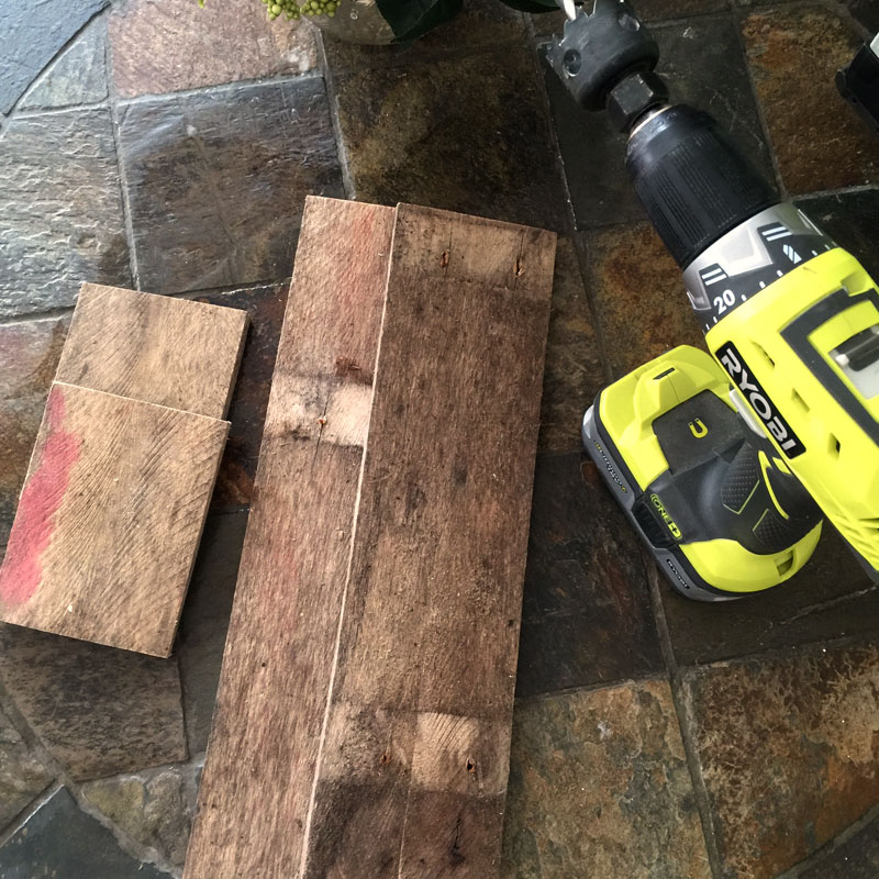 Cut scrap wood to make vintage specimen flower vase holder