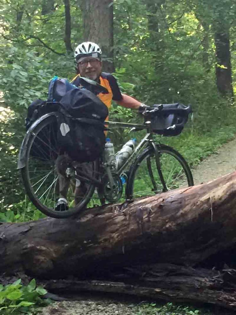 dan-carrying-my-bike-over-fallen-tree