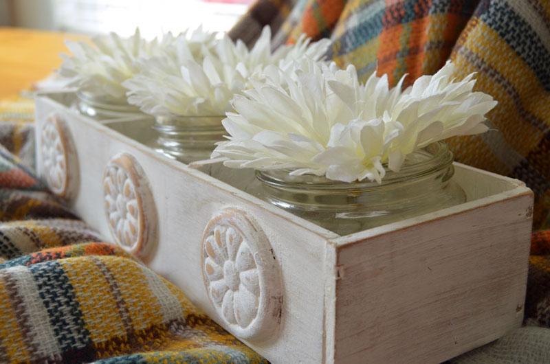homemade flower box holding mason jars