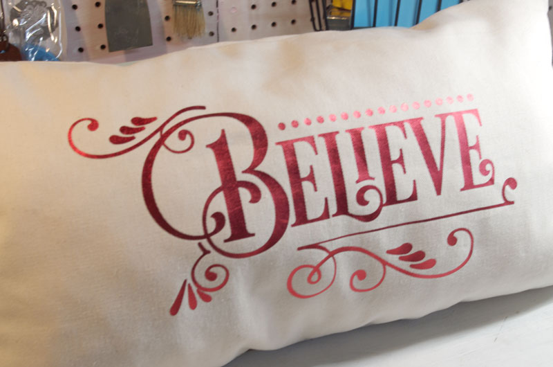Christmas side of dual holiday reversible pillow
