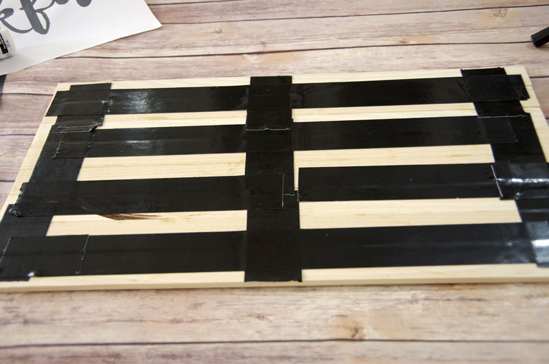 Glue and tape boards together for DIY Wood Plank Sign