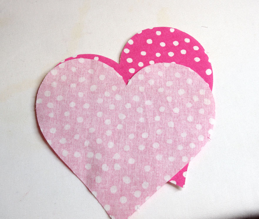 sew heart shapes together to make fabric heart coasters with a cricut
