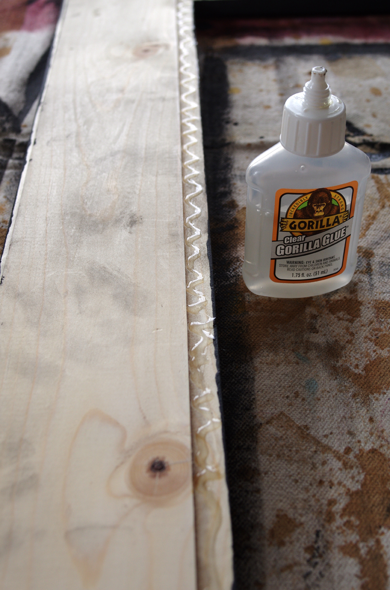 Use gorilla glue to attach sheet metal to wooden frame