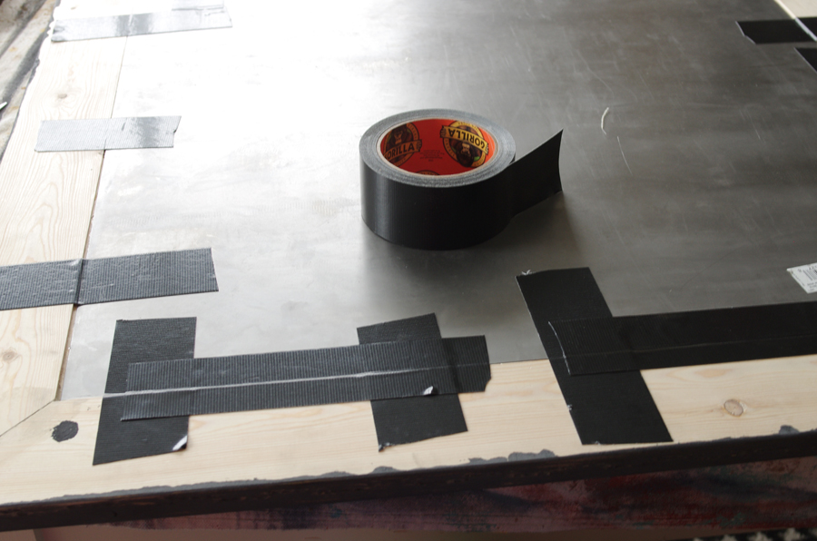 Use gorilla tape to reinforce attachment of sheet metal to wooden frame