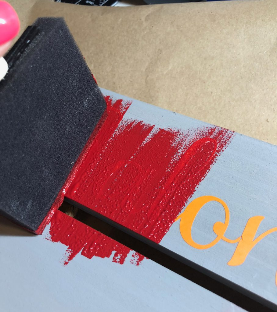 apply paint over letters with an up and down motion to avoid paint seeping under letters