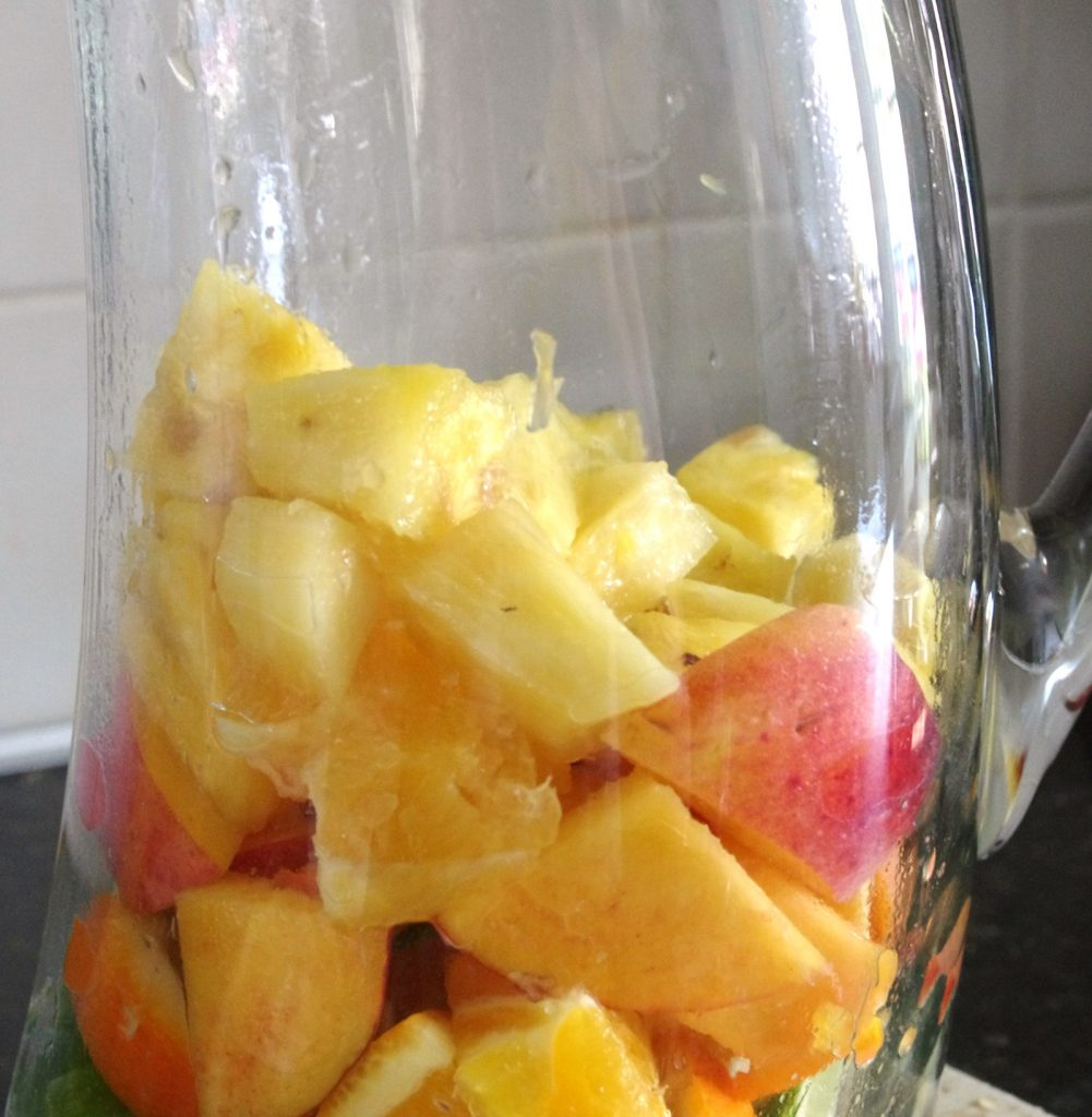 fill pitcher halfway with fruit to make white sangria