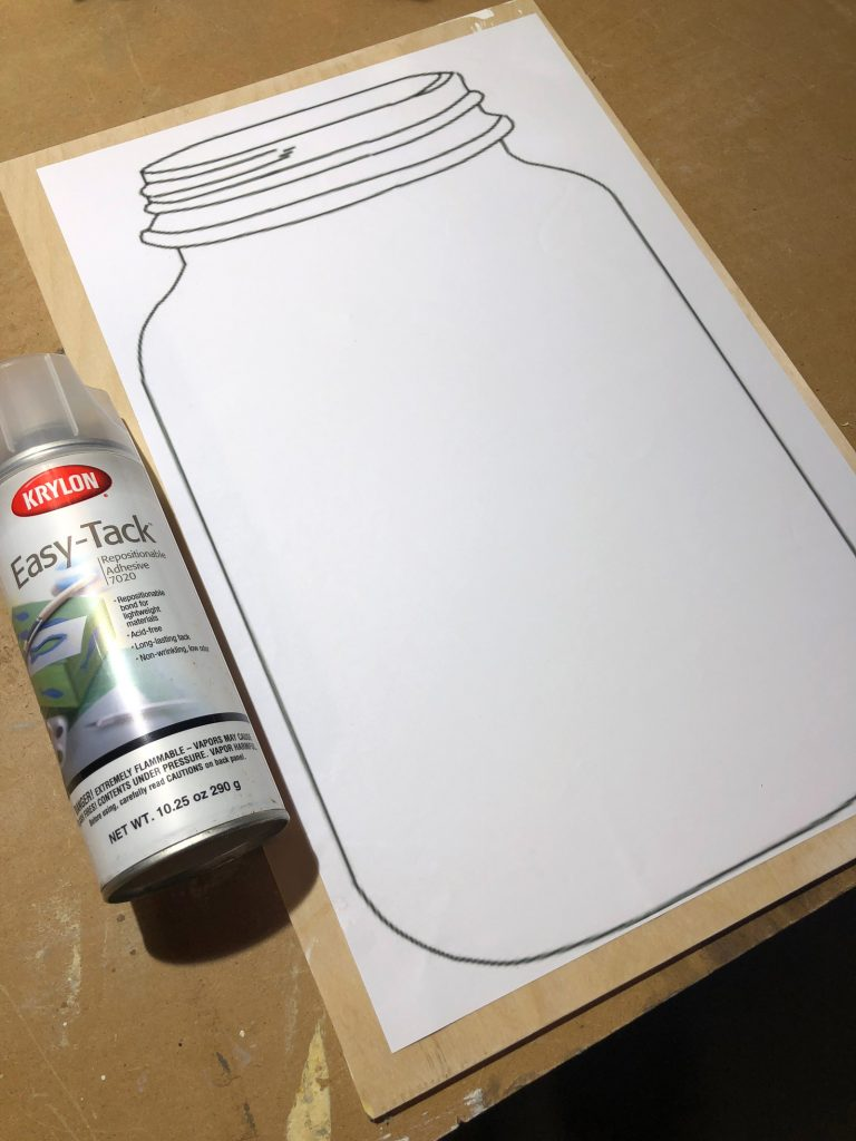 Step-2-Adhere-template-of-mason-jar-onto-plywood-with-repositionable-adhesive
