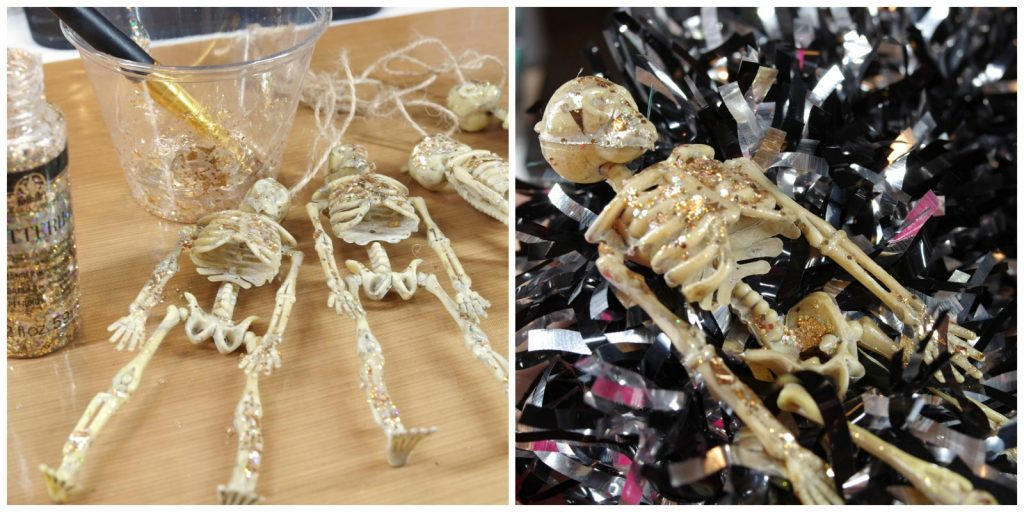 Add glitter to dollar store skeletons for dollar store halloween wreath