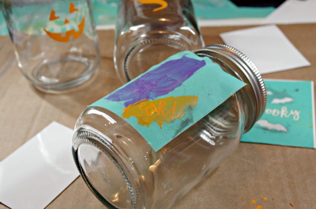 Apply chalk paste to make easy Halloween Mason Jars