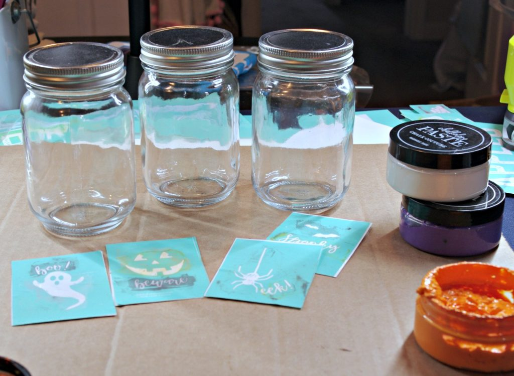 Gather jars, chalk couture transfers and chalk pastes to make easy Halloween Mason Jars
