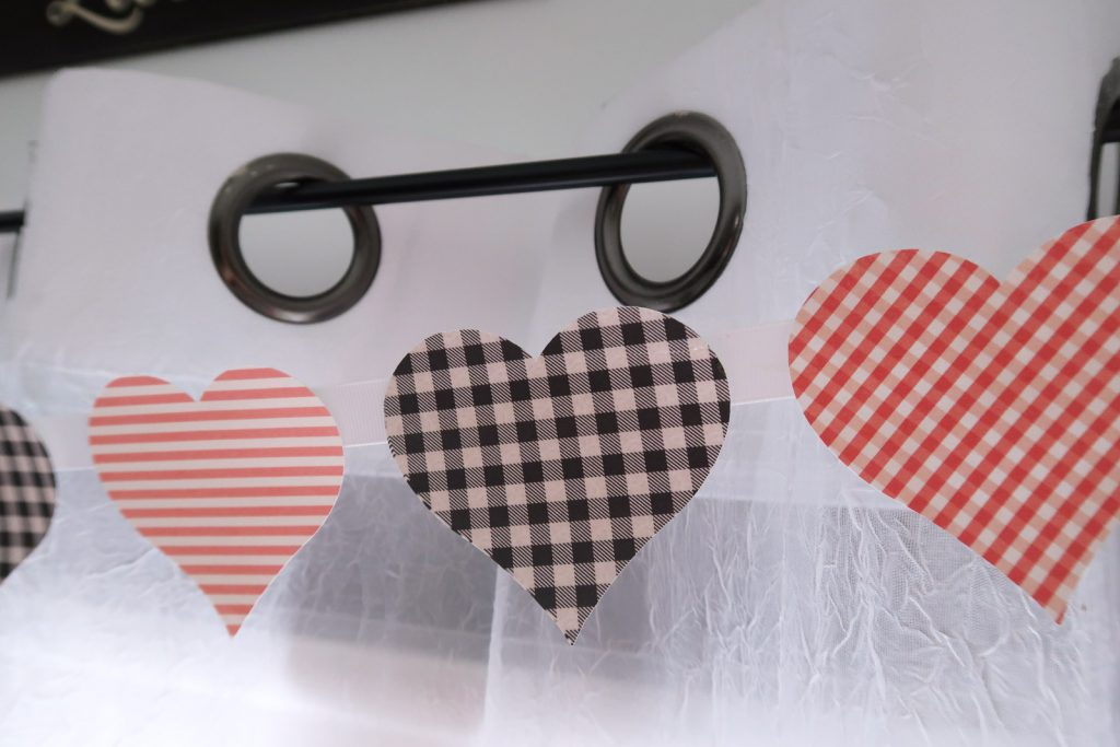 Print Then Cut Patterned Paper Heart Banner made with Cricut on curtain rod